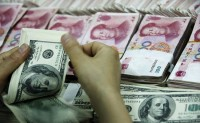 中国对外投资跃居全球第二 比吸引外资多36%
