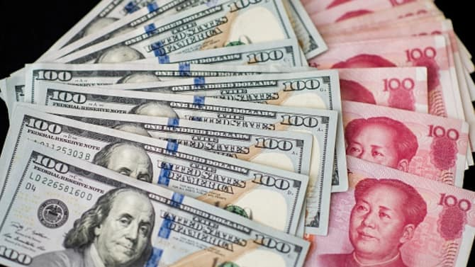Yuan And Dollar Banknotes Ahead Of Tenth Anniversary Of China's Yuan Reform